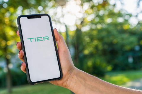 BERLIN, GERMANY AUGUST 2019: Woman hand holding iphone Xs with logo of TIER app displayed on a smartphone to rent a e-Scooter. Tier is a rental electric scooter company. Quick and easy way to travel- Stock Photo or Stock Video of rcfotostock | RC-Photo-Stock