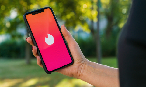 BERLIN, GERMANY AUGUST 2019: Woman hand holding iphone Xs with logo of Tinder app to log in. Tinder is a multiplatform people localization application for online romantic dating. It is very famous.- Stock Photo or Stock Video of rcfotostock | RC-Photo-Stock