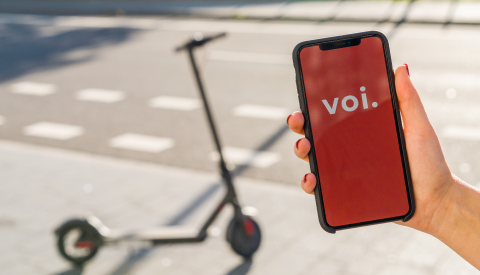 BERLIN, GERMANY AUGUST 2019: Woman hand holding iphone Xs with logo of VOI app displayed on a smartphone to rent a e-Scooter. Voi is a rental electric scooter company. Quick and easy way to travel. - Stock Photo or Stock Video of rcfotostock | RC-Photo-Stock