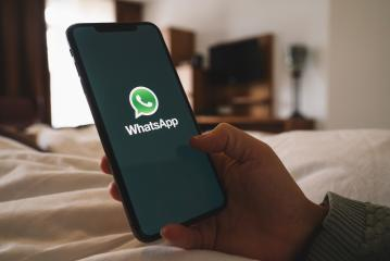 BERLIN, GERMANY AUGUST 2019: Woman holding a iPhone Xs opening Whatsapp app in a hotel room. WhatsApp messenger for sending messages via the Internet.- Stock Photo or Stock Video of rcfotostock | RC-Photo-Stock