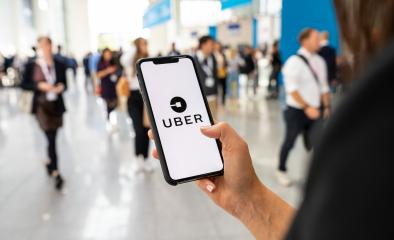 BERLIN, GERMANY JANUARY 2020:  Uber customer holding smartphone in the city to call via app a Uber driver. Uber is an American company offering transportation services online. Illustrative editorial.- Stock Photo or Stock Video of rcfotostock | RC-Photo-Stock