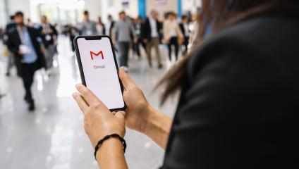 BERLIN, GERMANY JANUARY 2020: Business woman holding a iPhone with Google Gmail app logo on the display. Gmail is a most popular free Internet e-mail service provided by Google.- Stock Photo or Stock Video of rcfotostock | RC-Photo-Stock