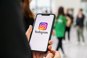 BERLIN, GERMANY JANUARY 2020: Woman hand holding iphone Xs with logo of instagram application in a pedestrian zone. Instagram is largest and most popular photograph social networking. : Stock Photo or Stock Video Download rcfotostock photos, images and assets rcfotostock | RC-Photo-Stock.: