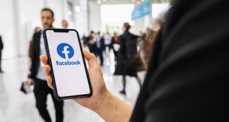 BERLIN, GERMANY JANUARY 2020: Woman hand holding iphone Xs with logo of Facebook application in a pedestrian zone. Facebook is an online social networking service founded February 2004 Mark Zuckerberg- Stock Photo or Stock Video of rcfotostock | RC-Photo-Stock