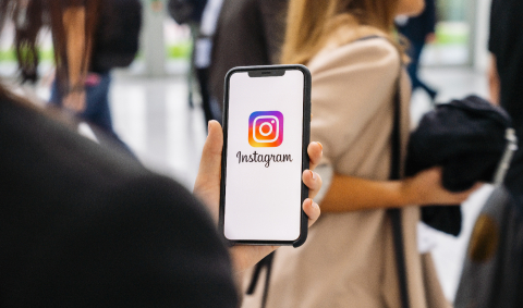 BERLIN, GERMANY JANUARY 2020: Woman hand holding iphone Xs with logo of instagram application in a pedestrian zone. Instagram is largest and most popular photograph social networking.- Stock Photo or Stock Video of rcfotostock | RC-Photo-Stock