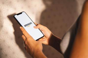 BERLIN, GERMANY JULY 2019:  iPhone Xs showing Amazon logo shopping online. Amazon.com, Inc. American international electronic commerce company.- Stock Photo or Stock Video of rcfotostock | RC-Photo-Stock
