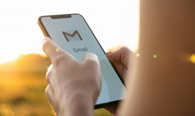 BERLIN, GERMANY JULY 2019: Business woman holding a iPhone with Google Gmail app logo on the display. Gmail is a most popular free Internet e-mail service provided by Google.- Stock Photo or Stock Video of rcfotostock | RC-Photo-Stock