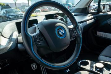 BERLIN, GERMANY JULY 2019: Detail of BMW i3 Electric Car Dashboard and Wheel. BMW i3 is a five-door urban electric car developed by the German manufacturer BMW.- Stock Photo or Stock Video of rcfotostock | RC-Photo-Stock