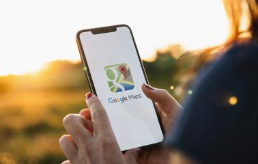 BERLIN, GERMANY JULY 2019: Hand Holding Smartphone with Google Maps application o. Google Maps is a service that provides information about geographical regions and sites around the world.- Stock Photo or Stock Video of rcfotostock | RC-Photo-Stock