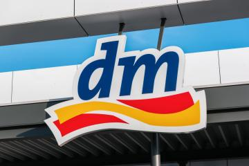 BERLIN, GERMANY JULY 2019: Logo of dm store. dm-drogerie markt is a chain of retail stores that sells cosmetics, healthcare and health food.  : Stock Photo or Stock Video Download rcfotostock photos, images and assets rcfotostock | RC-Photo-Stock.: