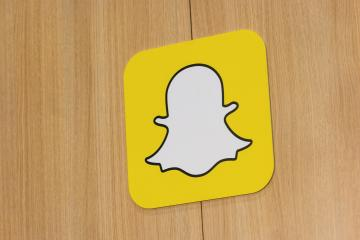 BERLIN, GERMANY JULY 2019: Snapchat logo with rainbow printed on a paper wall. Snapchat is a popular social media application for sharing messages, images and videos.- Stock Photo or Stock Video of rcfotostock | RC-Photo-Stock