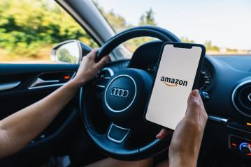 BERLIN, GERMANY JULY 2019: Woman hand holding iphone Xs Amazon logo on screen in a car. Amazon.com, Inc. American international electronic commerce company.- Stock Photo or Stock Video of rcfotostock | RC-Photo-Stock