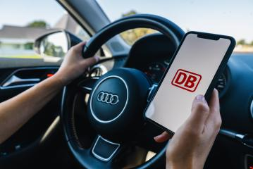 BERLIN, GERMANY JULY 2019: Woman hand holding iphone Xs with Deutsche Bahn logo on screen in a car. Deutsche Bahn (DB) is the main German train company for transporting goods and passengers.- Stock Photo or Stock Video of rcfotostock | RC-Photo-Stock