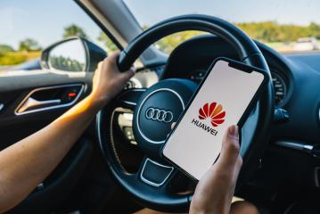 BERLIN, GERMANY JULY 2019: Woman hand holding iphone Xs with HUAWEI logo on screen in a car. Huawei Technologies Co., Ltd. is a Chinese multinational networking and telecommunications equipment.- Stock Photo or Stock Video of rcfotostock | RC-Photo-Stock