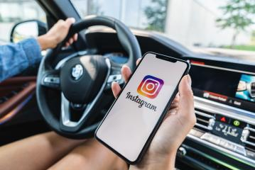 BERLIN, GERMANY JULY 2019: Woman hand holding iphone Xs with logo of instagram application in a car. Instagram is largest and most popular photograph social networking.- Stock Photo or Stock Video of rcfotostock | RC-Photo-Stock