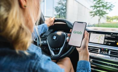 BERLIN, GERMANY JULY 2019: Woman hand holding iphone Xs with logo of Grab application in a car. Grab is smartphone app all-in-one transport booking in South-East Asia.- Stock Photo or Stock Video of rcfotostock | RC-Photo-Stock
