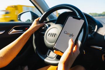 BERLIN, GERMANY JULY 2019: Woman hand holding iphone Xs with logo of google in a car. Google is an American technology and online services company- Stock Photo or Stock Video of rcfotostock | RC-Photo-Stock