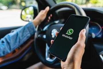 BERLIN, GERMANY JULY 2019: Woman holding a iPhone Xs opening Whatsapp app in a car. WhatsApp messenger for sending messages via the Internet.- Stock Photo or Stock Video of rcfotostock | RC-Photo-Stock