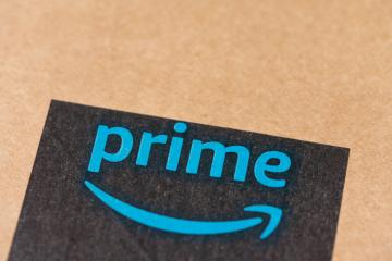 BERLIN, GERMANY JUNE 2020: Amazon Prime logotype printed on cardboard box security scotch tape. Prime is a service offered by online retailer Amazon for faster delivery of orders.- Stock Photo or Stock Video of rcfotostock | RC-Photo-Stock