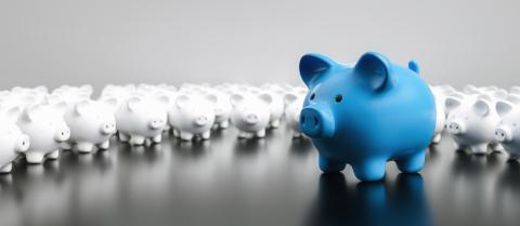 Big blue piggy bank with small white piggy banks on a table, banner size- Stock Photo or Stock Video of rcfotostock | RC-Photo-Stock