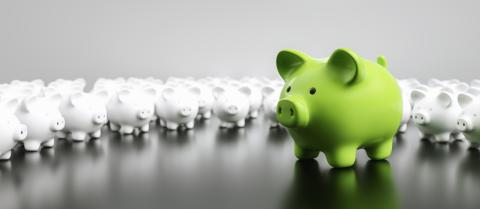 Big green piggy bank with small white piggy banks on a table, banner size- Stock Photo or Stock Video of rcfotostock | RC-Photo-Stock