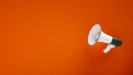 big megaphone in front of a red wall - 3D Rendering - Stock Photo or Stock Video of rcfotostock | RC-Photo-Stock