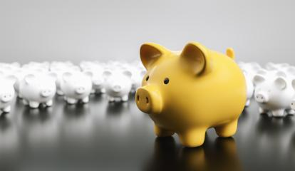 Big yellow piggy bank with small white piggy banks on a table : Stock Photo or Stock Video Download rcfotostock photos, images and assets rcfotostock | RC-Photo-Stock.: