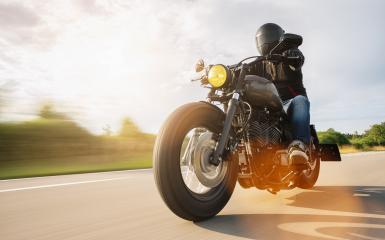 Biker fährt auf der Landstra0e mit Harley Sportster chopper - Stock Photo or Stock Video of rcfotostock | RC-Photo-Stock