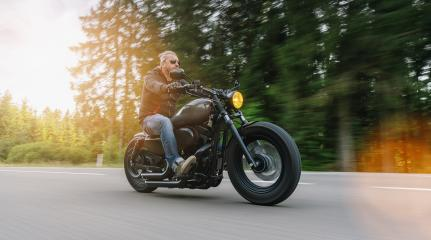 Biker riding motorcycle chopper on an empty road at sunny day- Stock Photo or Stock Video of rcfotostock | RC-Photo-Stock