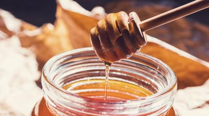 Bio Bee honey with wooden dipper - Honey's dessert concept image : Stock Photo or Stock Video Download rcfotostock photos, images and assets rcfotostock | RC-Photo-Stock.: