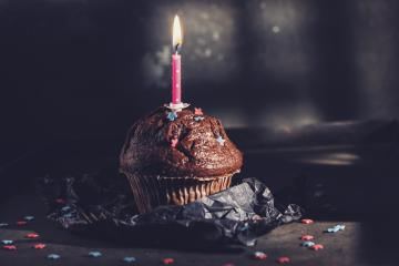 Birthday cupcake or muffin with Candle- Stock Photo or Stock Video of rcfotostock | RC-Photo-Stock