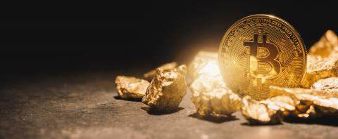 Bitcoin and a heap of Gold Nuggets - cryptocurrency concept image- Stock Photo or Stock Video of rcfotostock | RC-Photo-Stock