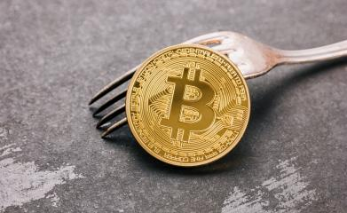 Bitcoin (BTC) on a Fork, digital cryptocurrency concept image- Stock Photo or Stock Video of rcfotostock | RC-Photo-Stock