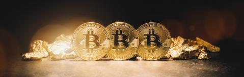 Bitcoin cryptocurrency and mound of gold nuggets  - Business concept image- Stock Photo or Stock Video of rcfotostock | RC-Photo-Stock