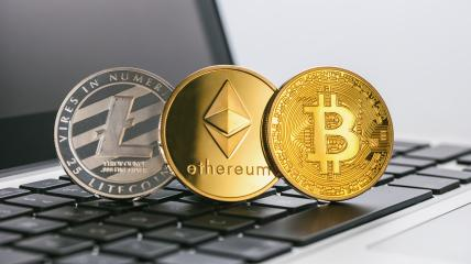 Bitcoin, Ethereum, Litecoin Digital cryptocurrencys on a notebook- Stock Photo or Stock Video of rcfotostock | RC-Photo-Stock