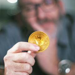 Bitcoin in hand of a businessman- Stock Photo or Stock Video of rcfotostock | RC-Photo-Stock