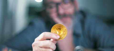 Bitcoin in hand of a businessman : Stock Photo or Stock Video Download rcfotostock photos, images and assets rcfotostock | RC-Photo-Stock.: