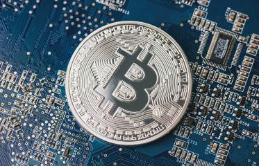 Bitcoin on a computer chip on motherboard- Stock Photo or Stock Video of rcfotostock | RC-Photo-Stock
