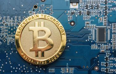 Bitcoin on a Mother board - cryptocurrency concept image- Stock Photo or Stock Video of rcfotostock | RC-Photo-Stock