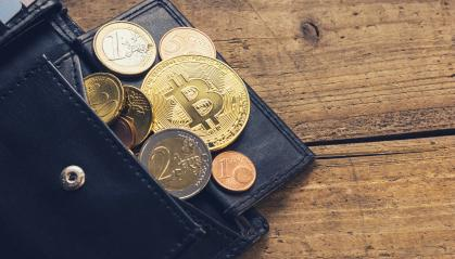 Bitcoin Wallet with euro coins- Stock Photo or Stock Video of rcfotostock | RC-Photo-Stock