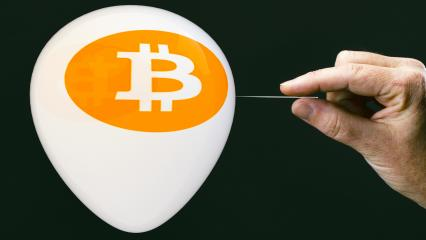 bitcoins - bit coin BTC the new virtual money on balloon with needle in hand before burst- Stock Photo or Stock Video of rcfotostock | RC-Photo-Stock