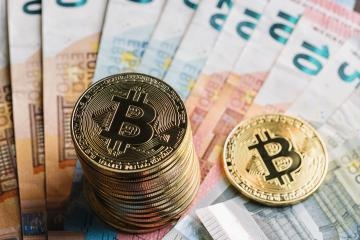 bitcoins stack Cryptocurrency on top of Euro banknotes- Stock Photo or Stock Video of rcfotostock | RC-Photo-Stock