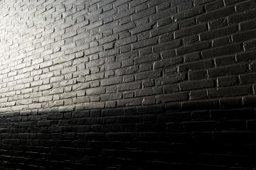 black painted brick wall with sunlight- Stock Photo or Stock Video of rcfotostock | RC-Photo-Stock