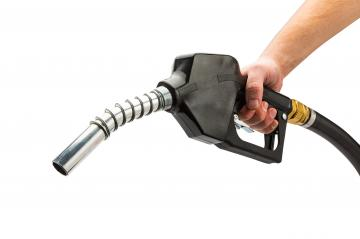 black petrol pump nozzle on white- Stock Photo or Stock Video of rcfotostock | RC-Photo-Stock