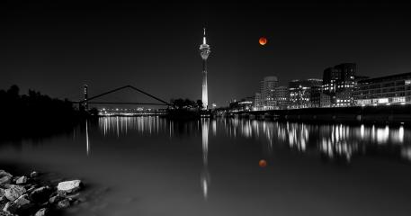 blood moon over Dusseldorf city : Stock Photo or Stock Video Download rcfotostock photos, images and assets rcfotostock | RC-Photo-Stock.: