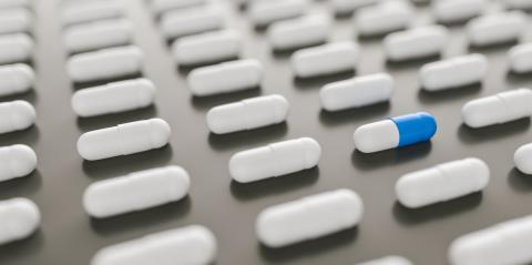 blue and white pills or capsules lies in a two rows, Pharmacy theme- Stock Photo or Stock Video of rcfotostock | RC-Photo-Stock