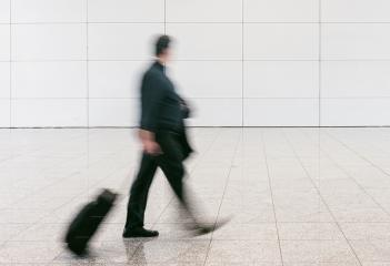 blurred anonymous businessman at a airport- Stock Photo or Stock Video of rcfotostock | RC-Photo-Stock