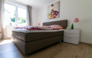 Blurred bedroom with white and colorful bed- Stock Photo or Stock Video of rcfotostock | RC-Photo-Stock