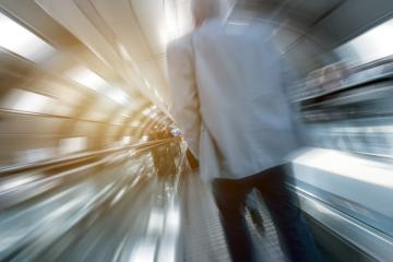 Blurred business commuters on a indoor walkway- Stock Photo or Stock Video of rcfotostock | RC-Photo-Stock
