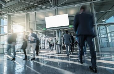 Blurred business people at a modern trade fair entrance- Stock Photo or Stock Video of rcfotostock | RC-Photo-Stock